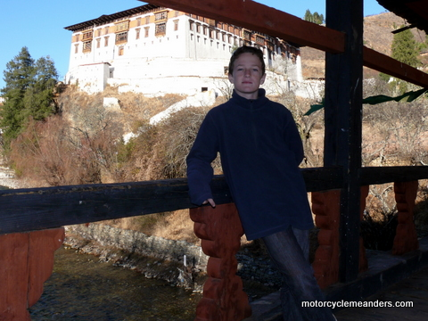 Dylan on bridge to Paro Dzong (background)